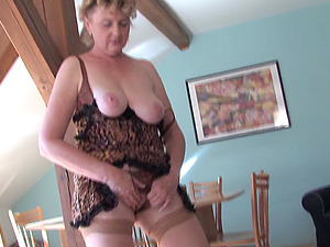 Leopard print is sexy on this mature honey fucking her faux-cock