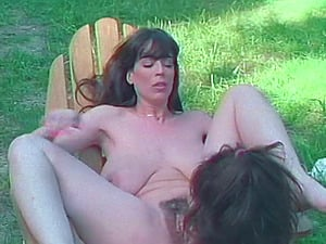 Outdoor retro seen of black-haired lezzy eating hairy cootchie