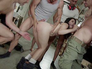 Pallid cutie is attacked by the horny guys with fully-erected dicks