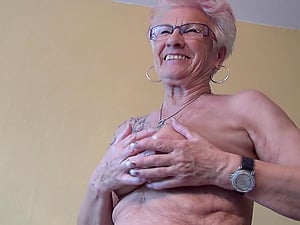 Tattooed granny exposes her big bean for your pleasure