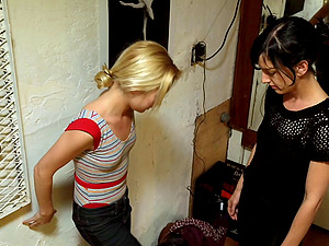 Skinny naked damsel tied up by her pretty mistress