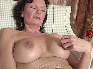 Steaming hot solo session featuring a big-titted mature looker