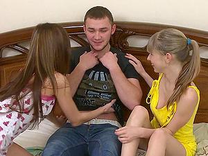 Pair of sweetest nubile femmes joyfully sharing their pal's big penis