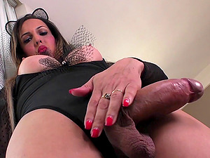 Hot shemale with round tits has an erection while playing with butthole