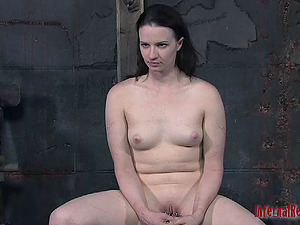 Ball-gagged black-haired spreads her gams for her master's skillful games