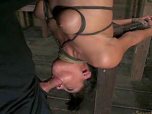 Upside down lovemaking victim deepthroats a pulsating lengthy love device