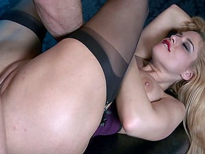 Tempting blonde with round hooters plays with playthings and has rectal romp