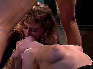 Curly-haired retro honies engage in a steamy erotic escapade