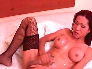 Black-haired t-girl with nice titties makes her boner stiff