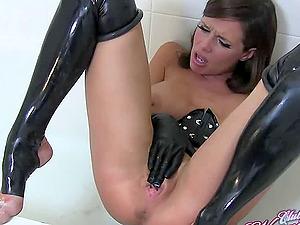 Veronica Avluv looking hot wearing gloves and leather touching herself