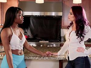 Monique Alexander and Mya Mays share a jizz-shotgun in a kitchen