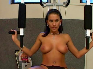 Chick sits on the gym dildoing her sweet cunt