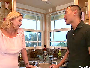Tattooed Asian dude fucks a hot blonde cougar in the kitchen