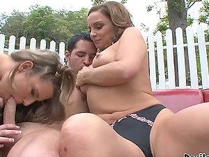 Maxi Booty and Rebecca Bardoux deepthroat a penis outdoors