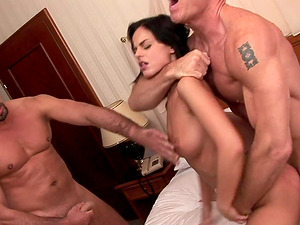 Two guys ravish Angelika Black in a hardcore threesome game