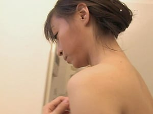 Naughty Asian girl takes off her dress for a nice shower