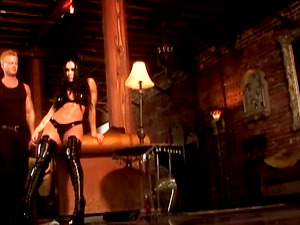 Brunette Cherokee wears black sexy boots during a sex session