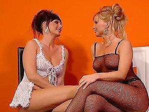 Silvia Saint fucks Sandra Sanchez's cock-squeezing labia with a strap on