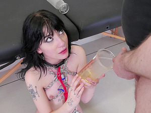Charlotte Sartre is a slave girl happy to play with a master's urine