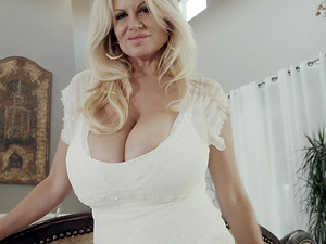 Kelly Madison is a blonde with big tits who loves touching her hole