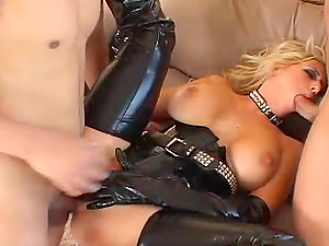 Candy Manson wears a latex outfit during a nasty threesome