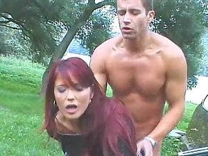 Erika Fire gets seduced and fucked by a biker in the forest