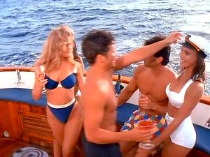 Three pmates, frolic nude on a yacht.