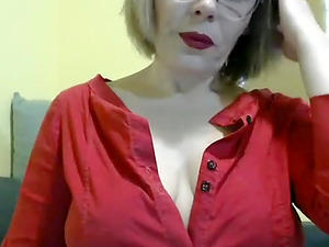 Naughty blonde in red clothes teases and exposes her tits and panties