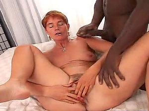 Experienced Mature Woman Sucking A Big Black Shaft.