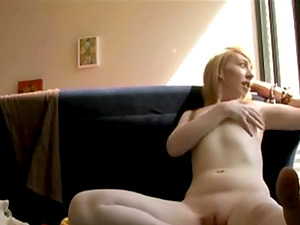 Sexy redhead girl strips and masturbates...