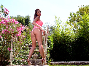 Kinky Satin Bloom squeezes her boobs while she masturbates outdoors