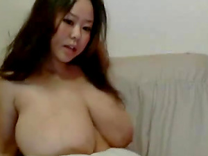 CUTE SEXY ASIAN GIRL WITH GIANT TITS