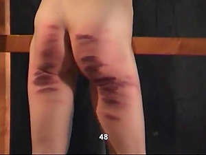 Horny mistress punishes a brunette chick with a long stick