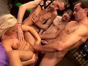 Lustful blonde stunner getting fucked by 50 old fellows