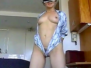 Hottie plays with big rubber dildo and reaches intense orgasm.