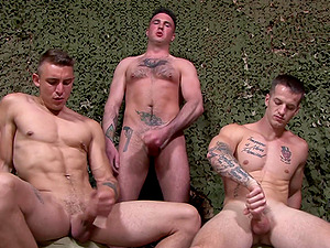 Military gay threesome in the field with horny dudes