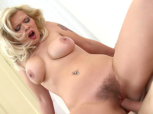 MILF Barbara Nova takes care of a cock and uses her heels to tease him