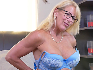 Blonde mature amateur Bianca J. strips with glasses on