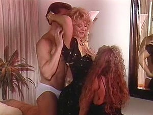 Peter North fucks Nina Hartley and Sunny Mckay after they suck his dick