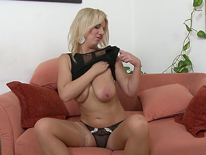 Blonde mature MILF Lucy Angel puts a vibrator between her tits