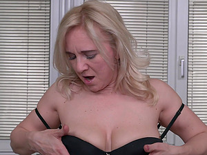 Solo blonde mature amateur Alma spreads her shaved pussy on the bed