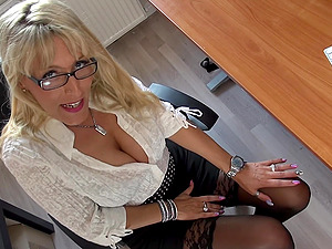 Nerdy busty blonde secretary Lana Vegas oils up her tits in the office