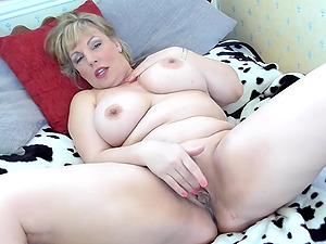 Buxom British mature amateur BBW Danielle spreads her shaved pussy
