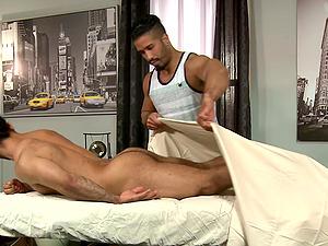 Latino macho gay masseuse gives his customer a blowjob and a massage