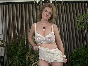 Skinny mature blonde granny Raina W. strips and exposes her mega tits
