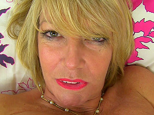 Mature amateur short haired blonde Amy exposes her huge tits