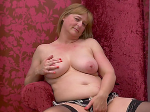 Busty blonde amateur mature British granny April O. strips