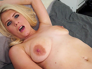 Blue eyed blonde MILF Ashleigh McKenzie masturbates passionately