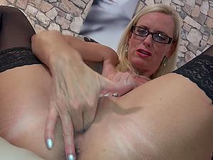 Mature amateur blonde secretary Dirty Tina masturbates with glasses on