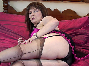 Buxom mature amateur British BBW granny Morgan B. strips in heels